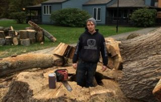 man standing in large log